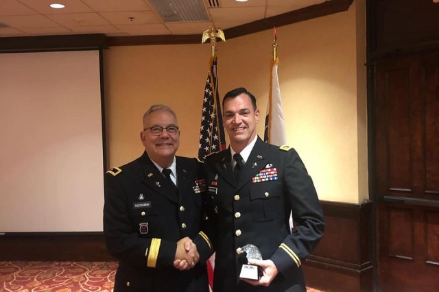 (From left) Deputy Chief of Chaplains, Brig. Gen. Robert Pleczkowski, congratulates Maj. Jake Snodgrass after he presented him with the 2019 Military Chaplains Association Distinguished Service Award, earlier this year. (Courtesy Photo)