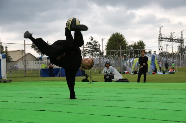 "A member of Goyo Crew performs ""freestyle basketball"" onstage Oct. 6 on Sagami General Depot, Japan, during the Fall Festival, an annual open-post event that brought nearly 9,000 visitors to the installation this year."