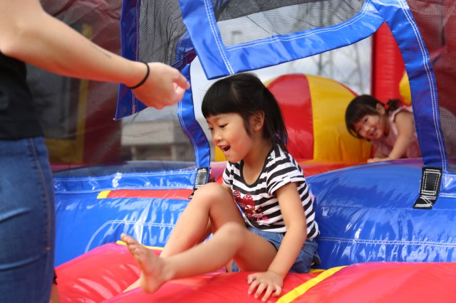 "A girl plays in an inflatable castle Oct. 6 at the Fall Festival, an annual open-post event on Sagami General Depot, Japan. The event also included the third annual half-marathon and ""ekiden"" relay race, whose competitors made up a large portion of the nearly 9,000 visitors."