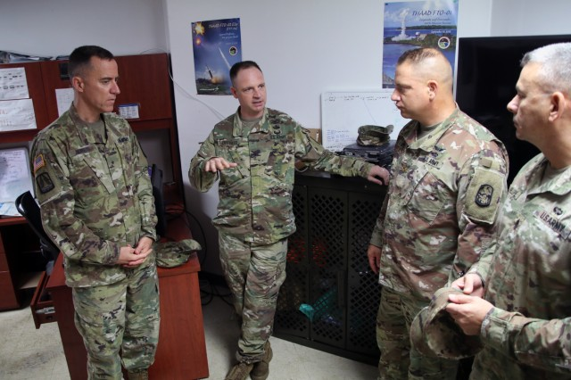 ANDERSON AIR FORCE BASE, Guam -- Col. Patrick Costello, 38th Air Defense Artillery Brigade commander and Maj. Bryan Z. Lipe, Task Force Talon officer in charge, discuss communication and satellite capabilities with Brig. Gen. Jan C. Norris, 311th Signal Command (Theater) during a Site Armadillo command walk-through, Oct. 7. The 38th ADA Brigade command team met the members of TF Talon, learned of their daily operations and welcomed them to Pacific Guardian Brigade team during a visit to Guam Oct. 6-8.