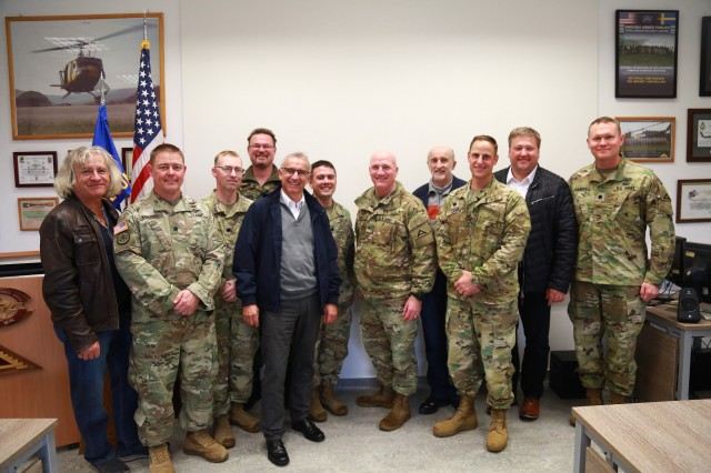 Observer Coach/Trainer teams from the Joint Multinational Readiness Center pose with Mayors from the local surrounding communities after a helicopter tour of the Hohenfels training area on Oct. 8.