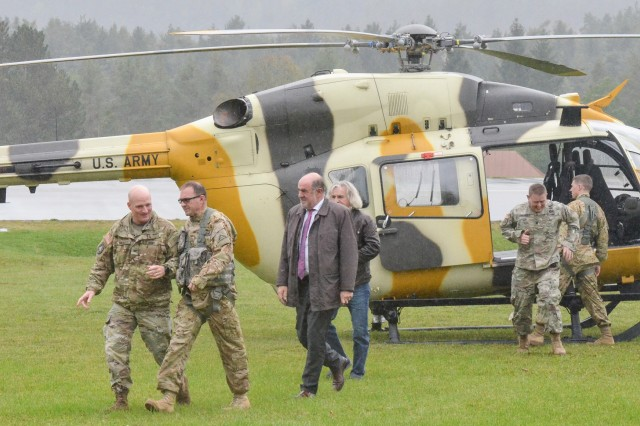 Observer Coach/Trainer teams from the Joint Multinational Readiness Center and Mayors from the local surrounding communities disembark after a helicopter tour of the Hohenfels training area on Oct. 8.