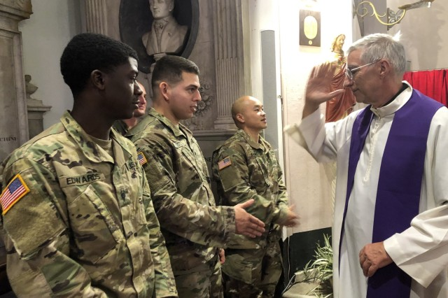 (left) Spc. Jaquay Edwards, Spc. Andy Soto and Staff. Sgt. Dennis Khang receive a military salute for the priest officiating Giuliano Ciaponi's funeral service 7 Oct. in Livorno.