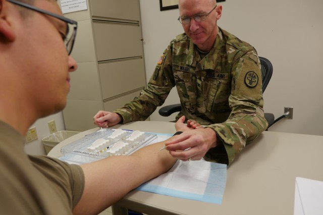 Army Col. (Dr.) Kirk Waibel, allergist/immunologist, prepares to give a mountain cedar allergy test to Army Sgt. Javier Pacheco in the Allergy/Immunology Clinic at Brooke Army Medical Center Oct. 8 , 2019. Mountain cedar is one of the most common allergens in central and south Texas.