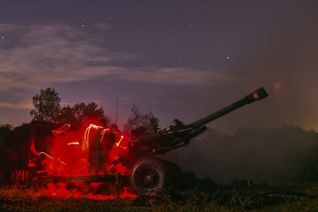U.S. Army paratroopers fire 105mm artillery rounds with an M119A3 Howitzer during Exercise Saber Junction at Grafenwoehr Training Area, Germany, Sept. 11, 2019. 4-319th Airborne Field Artillery Regiment (AFAR), 173rd Airborne Brigade is supporting th...