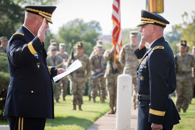 Lt. Gen. James Richardson performs the oath of office to new Brig. Gen. John Rafferty during Rafferty's promotion ceremony Oct. 4, 2019, at Fort Sill. Richardson is the Army Futures Command deputy commanding general; and Rafferty is the Long Range Precision Fires Cross Functional Team director.