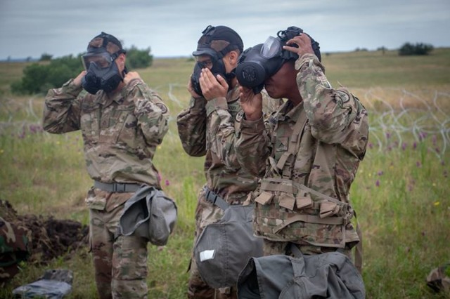 Pfc. Christian Daniels, Pfc. Abraham and Pvt. Josiah Martinez, with Bravo Troop, Regimental Support Squadron, 3rd Cavalry Regiment, sharpen their skills through Chemical, Biological, Radiological and Nuclear training drills during the regiment's field training exercise Sept. 15, at Fort Hood, Texas. The troopers are preparing for the upcoming rotation at the National Training Center at Fort Irwin, Calif. in mid-October. (U.S. Army photo by Sgt. Rene Rosas)
