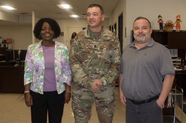 Command Sgt. Maj. Mario Terenas (center), command sergeant major for Fort Knox and U.S. Army Cadet Command, visits with Wendy Cherry, Director of Finance, and William Touchtone, military pay tech, at the Fort Knox Finance Office. Oct. 8, 2019.