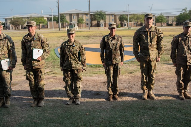 Six medical experts earn the right to wear the Expert Field Medical badge Oct. 4.  After a grueling week of testing their basic Soldier and combat medic skills, these six medical experts become recipients of the EFMB.