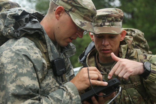 Staff Sgt. Jacob Rascon, right, and Sgt. David Hendrixson, both assigned to 3rd Brigade Combat Team, 101st Airborne Division (Air Assault), analyze prototyped cyber field equipment during Cyber Quest 2019. While the event traditionally has built up to a single annual exercise, future iterations will include smaller events year-round. (U.S. Army photo by Spc. TaMaya Eberhart, 55th Combat Camera)
