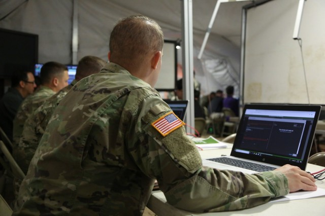 Soldiers analyze cyber communications during Cyber Quest 2019. The mission of Cyber Quest is to conduct prototyping experiments that demonstrate capabilities with the potential to quickly close high-priority technology gaps. (U.S. Army photo by Spc. TaMaya Eberhart, 55th Combat Camera)