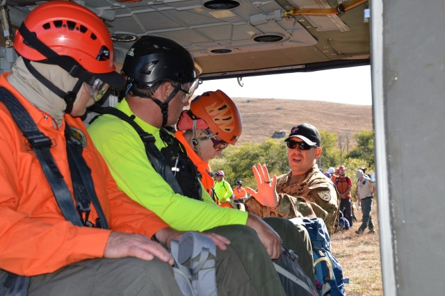 Cal Guard's Chief Warrant Officer 3 Michael Maxwell, a UH-60 Test Pilot and 19-year aviation veteran conducts 'cold'(engines off) training with volunteer search and rescue personnel at the helicopter safety and rescue training, Walker Creek Ranch, Petaluma, CA Oct 4-6. These SAR volunteers may one day find themselves transported by a Cal Guard Black Hawk helicopter, advance training will allow them familiarization. Maxwell and other crew members worked with the volunteers to load with and without gear, attach safety belts, and load with a litter containing a 180 lb. simulated 'victim'.