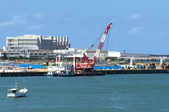 A view of dredging at Naha Military Port from across the harbor. Dredging equipment remained idle at Naha Military Port on Sept. 23, awaiting the all clear following passage of Large Typhoon Tapah, which caused strong winds and rough seas as it went through on Sept. 21.