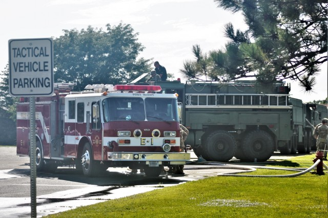 Military and civilian firefighters complete  driver-operator certification training Aug. 19, 2019, on the cantonment area at Fort McCoy, Wis. A Fort McCoy firefighter and 19 Army Reserve Soldiers received their certifications on fire trucks during the training. (U.S. Army Photo by Scott T. Sturkol, Public Affairs Office, Fort McCoy, Wis.)