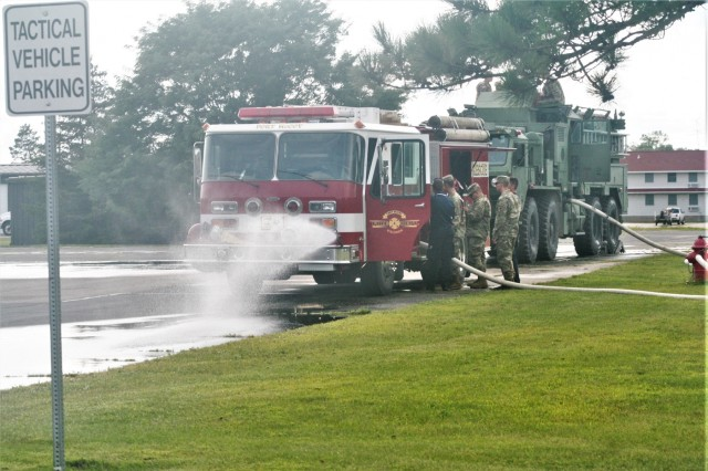 Military and civilian firefighters complete  driver-operator certification training Aug. 16, 2019, on the cantonment area at Fort McCoy, Wis. A Fort McCoy firefighter and 19 Army Reserve Soldiers received their certifications on fire trucks during the training. (U.S. Army Photo by Scott T. Sturkol, Public Affairs Office, Fort McCoy, Wis.)