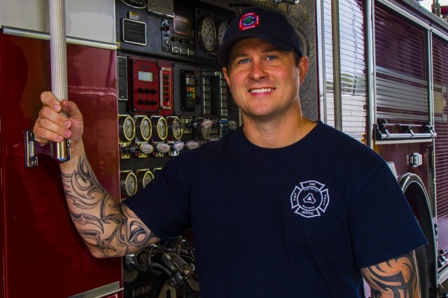 Cole Stanek, Fort McCoy Fire Department firefighter, poses for a portrait at Station One on Fort McCoy, Wisconsin, Aug. 12, 2019. Stanek, a native of Hillsboro, Wisconsin, worked at Fort McCoy Police Department for 16 years and volunteered at Union Center Fire Department for four years before joining FMFD. The department operates two stations that serve the 60,000 acre Army installation and its surrounding cities through various capacities like emergency medical services, aircraft rescue and firefighting, search and rescue and more. (U.S. Army Reserve photo by Spc. Nicole Baker)