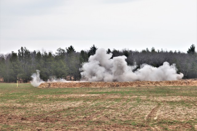 Munitions are detonated in an explosion April 17, 2019, at a demolition range on North Post at Fort McCoy, Wis. The action was part of training for the 89B Ammunition Supply Course taught by the 13th Battalion, 100th Regiment at Fort McCoy. According to course instruction, all ammunition specialists working in ammunition storage areas must know how to destroy stocks of ammunition to prevent it from falling into the hands of an enemy. They must also be able to destroy unserviceable ammunition before it deteriorates to the point of becoming hazardous to fire, store, or transport safely. This training is completed during each session of the Ammunition Supply Course. Approximately 15 course students and several instructors completed demolitions training at the range. (U.S. Army Photo by Scott T. Sturkol, Public Affairs Office, Fort McCoy, Wis.)