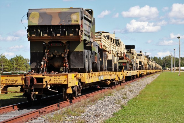 Military vehicles and equipment belonging to the 829th Engineer Company are loaded on railcars Sept. 25, 2019, at Fort McCoy, Wis. The equipment was being shipped for an overseas deployment later in the year. The rail loading and related work was completed by 829th and employees with the Fort McCoy Logistics Readiness Center Transportation Division. (U.S. Army Photo by Scott T. Sturkol, Public Affairs Office, Fort McCoy, Wis.)