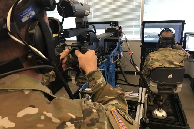 A gunner and his vehicle commander test a prototype of a virtual collective trainer configured as a high mobility multipurpose wheeled vehicle during a synthetic training environment user assessment in September in Orlando, Fla.