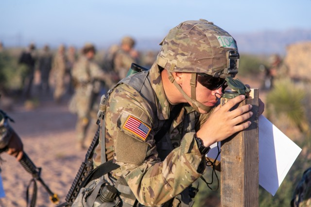 U.S. Army Pvt. 1st Class Thomas F. DeMarsico, a combat medic assigned to headquarters and headquarters company, 2nd Infantry Battalion, 4th Infantry Regiment, 3rd Brigade Combat Team, 10th Mountain Divsion at Fort Polk, Louisiana, checks to make sure his compass is calibrated prior to the start of land navigation testing for the expert field medical badge on Fort Bliss, Texas, Sep. 6, 2019. Candidates competing for the EFMB must successfully complete both day and night land navigation training to proceed to the next round of testing. DeMarsico has since been promoted to specialist.