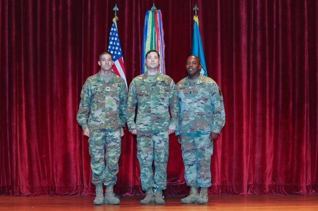 FORT BENNING, Ga. -- Col. Townley Hedrick, left, U.S. Army Infantry School commandant, and Maneuver Center of Excellence Command Sgt. Maj. Martin S. Celestine, right, recognize Sgt. 1st Class Louis Ziacik during the MCoE Quarterly Excellence Ceremony Sept. 26, 2019. Ziacik, chief of instructors for the Henry Caro Noncommissioned Officers Academy, formally received the Master Army Instructor Badge at a ceremony here, becoming the 41st recipient across the Army and the first at Fort Benning. (U.S. Army photo by Markeith Horace, Maneuver Center of Excellence, Fort Benning Public Affairs)