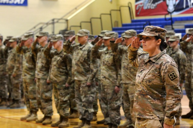 U.S. Army Reserve 1st Lt. Alyssa Pybus, 465th Engineer Company, 926th Engineer Battalion, 926th Engineer Brigade, 412th Theater Engineer Command, based in Birmingham, Ala., presents arms during the company's deployment ceremony at Ramsay High School gymnasium in Birmingham Dec. 9, 2018. The company is deploying to Djibouti, Africa, in support of Operation Enduring Freedom.
