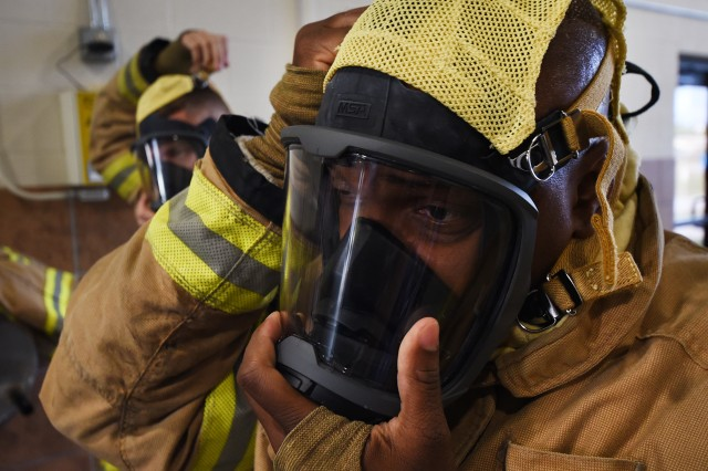 Command Sgt. Maj. Garrick Griffin, Fort Knox garrison senior enlisted advisor, adjusts his mask prior to participating in a live-fire exercise with Fort Knox Fire Oct. 9, 2019.
