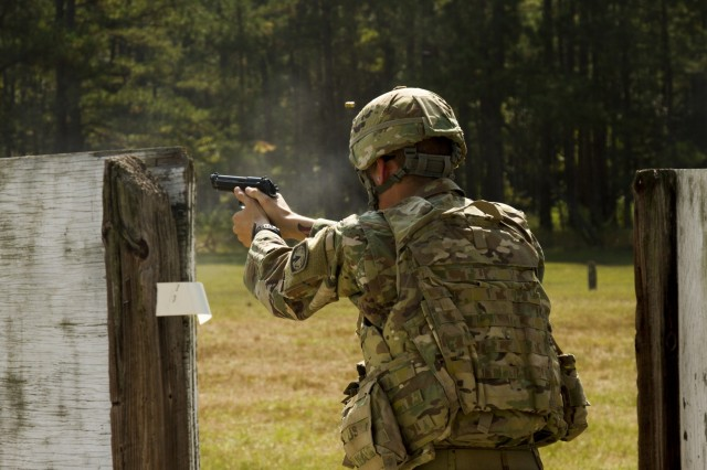 Spc. Branden Depouli, a military police officer with the 549th Military Police Company, 385th Military Police Battalion, 16th Military Police Brigade, fires his M9 pistol during an Excellence in Competition match on Fort Stewart, Ga., Oct. 3, 2019. The competition ensures Soldiers have a chance to better familiarize themselves with their primary weapons. (U.S. Army photo by Spc. Jason Greaves)