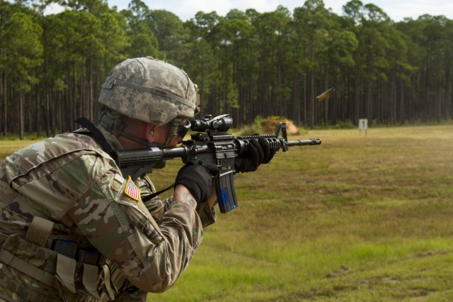 Spc. Micah Wright, a military police officer with the 549th Military Police Company, 385th Military Police Battalion, 16th Military Police Brigade, fires his M4 carbine while competing in an Excellence in Competition match at Fort Stewart, Ga., Oct. 7, 2019. The competition's top 10 percent were awarded the coveted EIC badge. (U.S. Army photo by Spc. Jason Greaves)