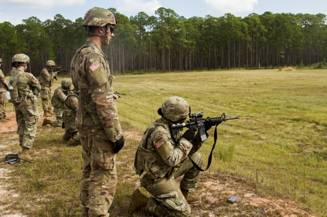 Spc. Carlisia Marshall, a military police officer with the 549th Military Police Company, 385th Military Police Battalion, 16th Military Police Brigade, fires her M4 carbine while competing in an Excellence in Competition match at Fort Stewart, Ga., Oct. 3, 2019. Spc. Noah Shireman , also an MP, stands in as her lane safety during the competition. The competition ensures Soldiers have a chance to better familiarize themselves with their primary weapons and become competent on their weapons. (U.S. Army photo by Spc. Jason Greaves)
