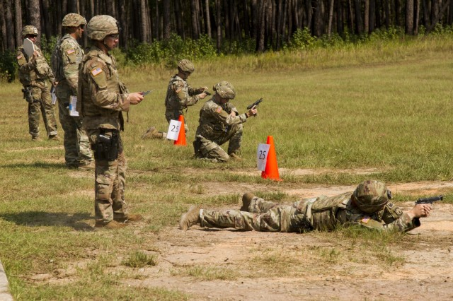Military police officers with the 549th Military Police Company, 385th Military Police Battalion, 16th Military Police Brigade, compete in the M9 pistol portion of an Excellence in Competition match at Fort Stewart, Ga., Oct. 3, 2019. According to organizers at the competition, this is the first time the EIC was hosted at Fort Stewart. (U.S. Army photo by Spc. Jason Greaves)