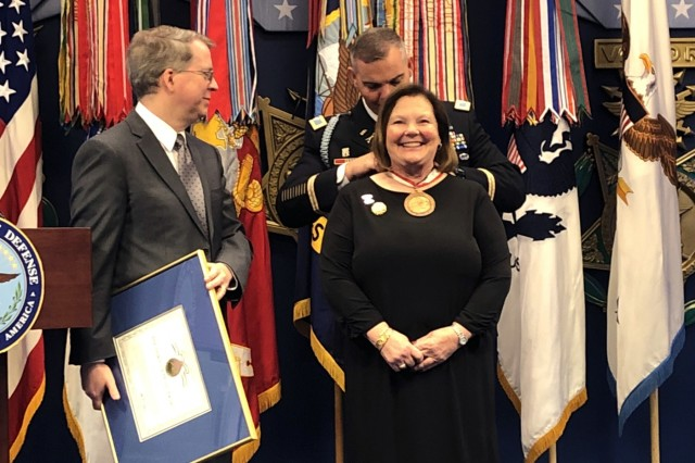 Cindy Boyd, president of Precision Contracting Services Inc. in Florida, receives the Spirit of Hope award presented by Col. Trent Upton, commander of 1st Armored Brigade Combat Team, 3rd Infantry Division, at the Pentagon in Washington D.C., September 28, 2019. The Department of Defense presented Boyd with the award for displaying selfless service and going to extraordinary measures to contribute to service members.