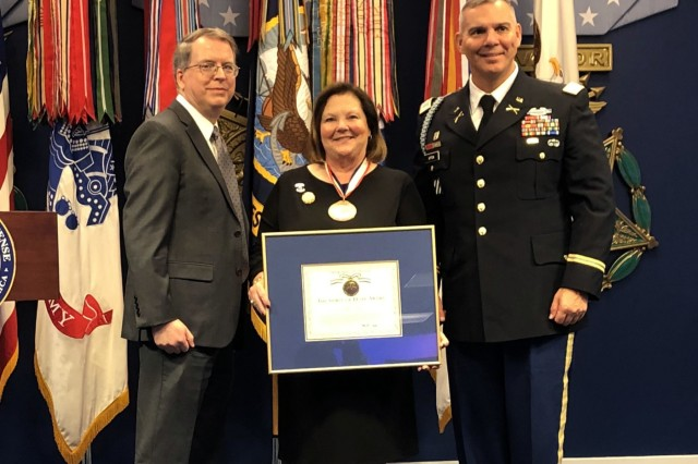 Cindy Boyd, president of Precision Contracting Services Inc. in Florida, stands with David Norquist, the U.S. Deputy Secretary of Defense, and 1st Sgt. Brian Andrade, first sergeant of 5th Squadron, 7th Cavalry Regiment, 1st Armored Brigade Combat Team, 3rd Infantry Division, after she received the Spirit of Hope award presented at the Pentagon in Washington D.C., September 28, 2019. The Department of Defense presented Boyd with the award for displaying selfless service and going to extraordinary measures to contribute to service members.