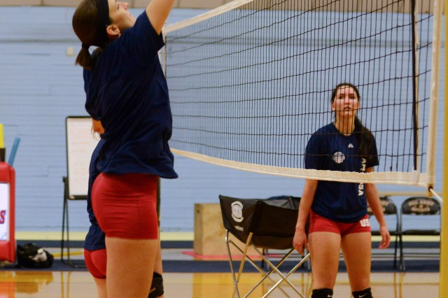 Middle blocker Justine Stremick attempts to block during the Armed Forces women's volleyball practice Oct. 3 at Fort Indiantown Gap, Pa.