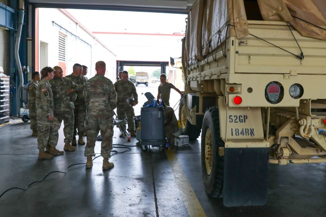Members of the 101st Sustainment Brigade command team visit the 584th Support Maintenance Company to get a better understanding of Operation Eagle Wrench. The operation is an effort to improve vehicle and maintenance readiness across the 101st Airborne Division (Air Assault).