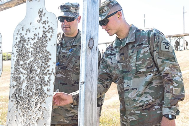 2nd Lt. Ryan Kossover (right) and Staff Sgt. Patrick Shepherd, 31st Engineer Battalion, verify trainee shot groupings. Kossover was recently named the Maneuver Support Center of Excellence's first Junior Officer of the Quarter.