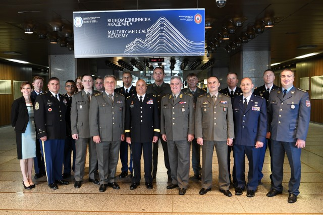 Members of a visiting Ohio National Guard delegation stand for a photo with a group of Serbian Armed Forces Sept. 12, 2019, at the Military Medical Academy in Belgrade, Serbia. The delegation met with staff members at the academy to discuss their capabilities.