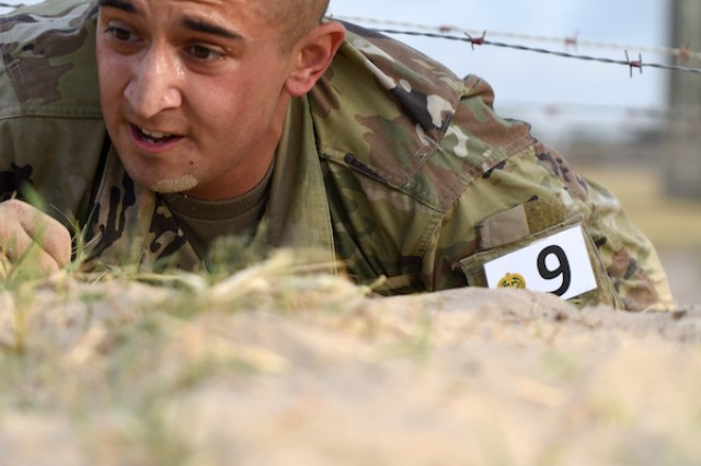 Staff Sgt.  Matthew T. Martinez, U.S. Army Intelligence Center of Excellence negotiates and obstacle course during the 2019 Drill Sergeant of the Year (DSOY) Competition at Joint Base San Antonio-Fort Sam Houston and Camp Bullis, Texas in August. (U.S. Army photo by Jose Rodriguez)