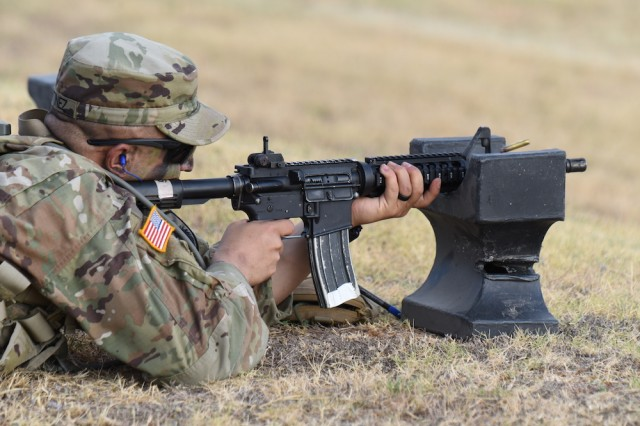 Staff Sgt.  Matthew T. Martinez, U.S. Army Intelligence Center of Excellence fires a M4 Carbine during the 2019 Drill Sergeant of the Year (DSOY) Competition at Joint Base San Antonio-Fort Sam Houston and Camp Bullis, Texas in August. (U.S. Army photo by Jose Rodriguez)