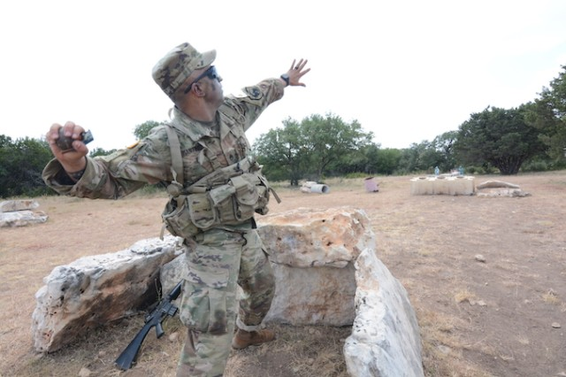 Staff Sgt. Matthew T. Martinez, U.S. Army Intelligence Center of Excellence throws a grenade during the 2019 Drill Sergeant of the Year (DSOY) Competition at Joint Base San Antonio-Fort Sam Houston and Camp Bullis, Texas in August. (U.S. Army photo by Jose Rodriguez)