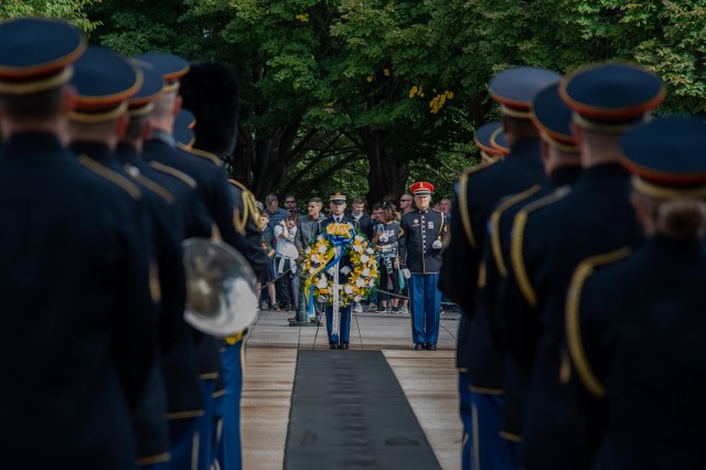 "Members of The U.S. Army Band ""Pershing's Own"" and a tomb sentinel from the 3d U.S. Infantry Regiment (The Old Guard) support an Army Honors Wreath Ceremony at the Tomb of the Unknown Soldier at Arlington National Cemetery, Virginia, October 9, 2019. The ceremony, in honor of the interagency partnership between the U.S. Secret Service and Joint Force Headquarters-National Capital Region, was hosted by Maj. Gen. Omar J. Jones IV, commanding general, Joint Force Headquarters - National Capital Region and the U.S. Army Military District of Washington."
