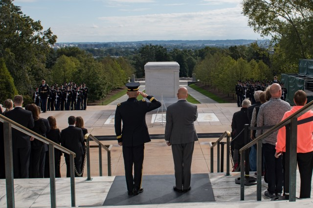 Maj. Gen. Omar J. Jones IV (left), commanding general, Joint Force Headquarters - National Capital Region and the U.S. Army Military District of Washington, and Matthew Miller (right), U.S. Secret Service Washington Field Office Special Agent in Charge, render honors during an Army Honors Wreath Ceremony at the Tomb of the Unknown Soldier at Arlington National Cemetery, Virginia, October 9, 2019. The ceremony was conducted in honor of the interagency partnership between the U.S. Secret Service and Joint Force Headquarters-National Capital Region.