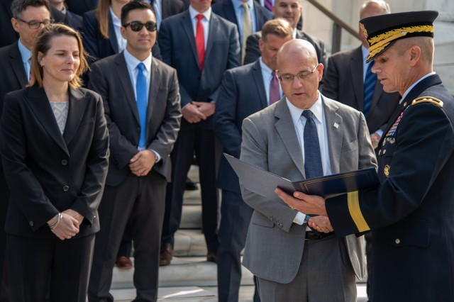Matthew Miller (center right), U.S. Secret Service Washington Field Office Special Agent in Charge, receives a certificate from Maj. Gen. Omar J. Jones IV, commanding general, Joint Force Headquarters - National Capital Region and the U.S. Army Military District of Washington, after participating in an Army Honors Wreath Ceremony at the Tomb of the Unknown Soldier at Arlington National Cemetery, Virginia, October 9, 2019. The ceremony was conducted in honor of the interagency partnership between the U.S. Secret Service and Joint Force Headquarters-National Capital Region.