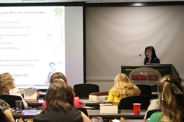 """Carolyn Vo Farmer, All Up Round and Canister deputy project manager for the Army Hypersonic Project Office, presents """"The Power of Focus to Influence Personal and Professional Change,"""" at a recent Tennessee Valley Chapter of Women in Defense mentoring event."""