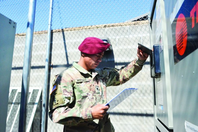 Specialist Nathaniel Martinez, Headquarters and Headquarters Company, 5th Special Forces Group (Airborne), Fort Campbell, Ky., inspects an air conditioning unit outside of barracks. He is part of a team that maintains 74 buildings and more than 1.5 million square feet for 5th SFG (A).