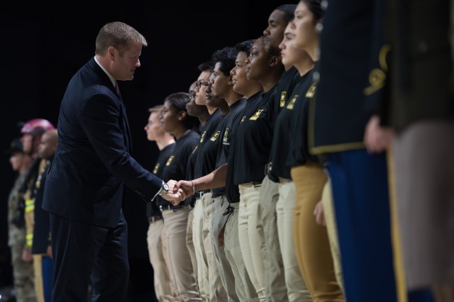 Secretary of the Army Ryan D. McCarthy congratulates new recruits after they took the Oath of Enlistment during the opening ceremony of the Association of the U.S. Army Annual Meeting and Exposition in Washington, D.C., Oct. 14, 2019.