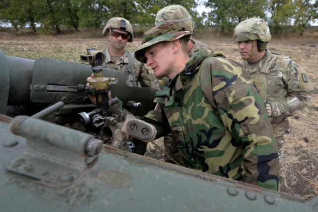 Soldiers from the North Carolina and Alabama National Guard learn more about Moldovan artillery training and tactics during Operation Fire Shield 2019 in Moldova, Sept. 17, 2019.