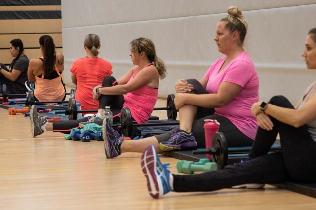 Participants prepare themselves for an intense workout session before the 6-Week Boot Camp Ultimate Rejuvenation held at the Katterbach Fitness Center, Katterbach Kaserne, Germany. The boot camp is a 6-week comprehensive, customized fitness program. (U.S. Army Photo by Pfc. Ashunteia' Smith)