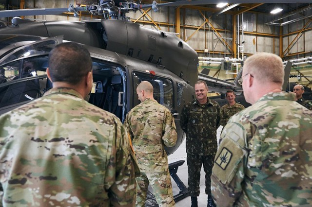 Lt. Gen. Achilles Furlan Neto, the Brazilian Army's Operations Officer, inspects a UH-72 Light Utility Helicopter flown by the New York Army National Guard at Army Aviation Support Facility #3 at Albany International Airport in Latham, N.Y. on October 7, 2019. Furlan spent a week visiting New York National Guard operating locations in the Albany, N.Y-area, Camp Smith Training Site and New York City as part of the New York National Guard's state partnership program with the Brazilian military.