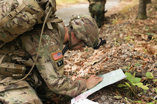 Spc. David Chambers, the 2019 Soldier of the Year,  receives grid coordinates to call in a simulated unexploded ordnance (UXO) during the 2019 Best Warrior Competition at Fort A.P. Hill, Va., Oct. 6, 2019. The Best Warrior Competition represents highly trained, disciplined and physically fit Soldiers from cohesive teams across the Army capable of winning on any battlefield.